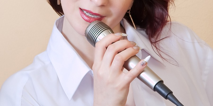 Girl singing in a microphone