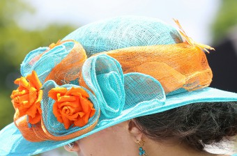 Elegant woman with her beautiful hat at the Prix de Diane, France